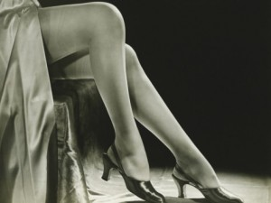 george-marks-woman-in-stockings-sitting-on-chair-close-up-of-legs