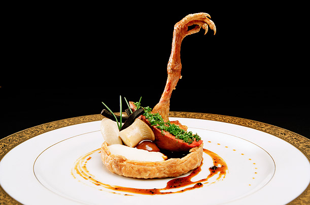 """A 1903 August Escoffier recipe, Suprême de Pigeonneaux à la Saint-Clair, as fantastically interpreted as a baroque tartlet by the awardwinning chef Grant Achatz. His next restaurant, called Next, will open in February 2011 and will have a century-spanning menu. Image by Martha Camarillo from the 20 December 2010 Time article """"The Miracle Worker."""""""